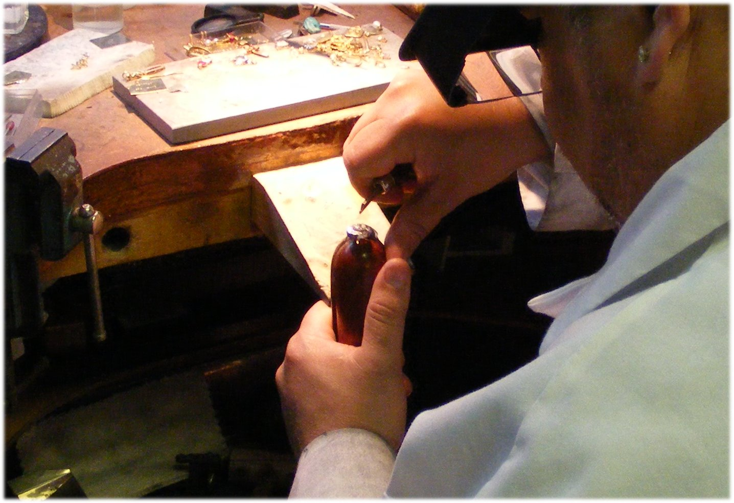 A goldsmith repairing jewelry.